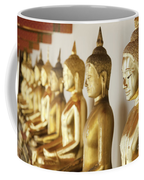 Thailand Coffee Mug featuring the photograph Row Of Buddhas by Anthony Totah