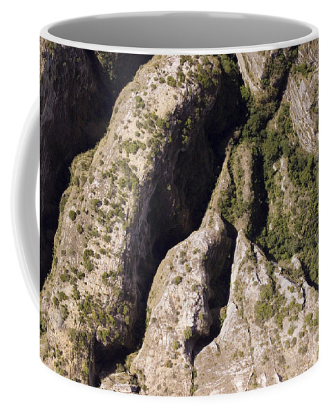 Africa Coffee Mug featuring the photograph Runiiforme Dissected Sandstone Hills by Michael Fay