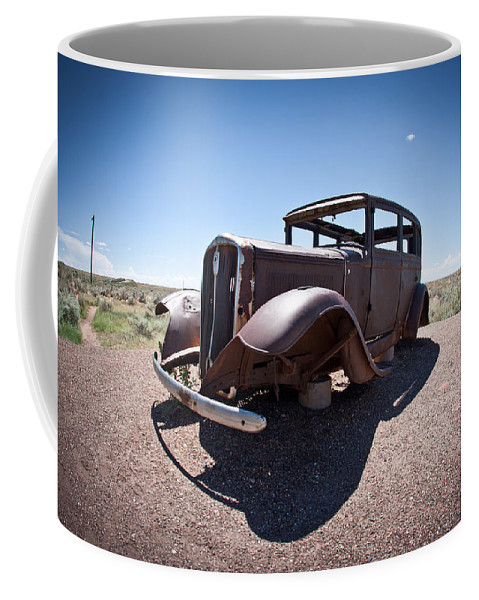 Painted Coffee Mug featuring the photograph Rusted Old Car On Route 66 by Robert J Caputo