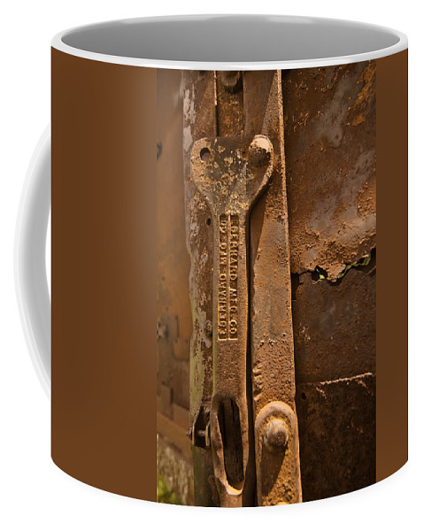 Rust Coffee Mug featuring the photograph Rusty Truck Part by Sven Brogren