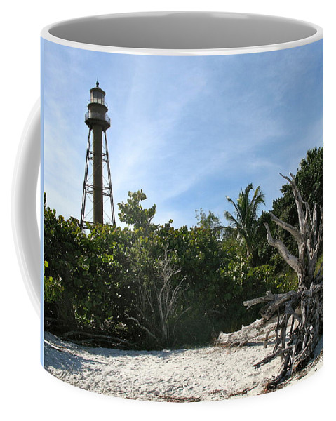 Sanibel Lighthouse Coffee Mug featuring the photograph Sanibel Light And Driftwood by Christiane Schulze Art And Photography