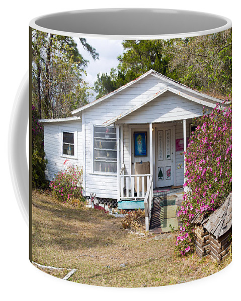 Cabin Coffee Mug featuring the photograph Santa And Mrs Claus Spend The Spring Months Relaxing by Allan Hughes