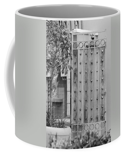 Black And White Coffee Mug featuring the photograph Sea Horse Gate by Rob Hans