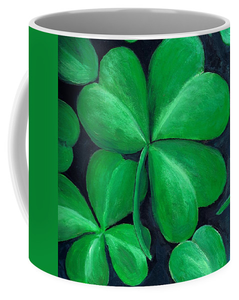 Shamrock Coffee Mug featuring the painting Shamrocks by Nancy Mueller