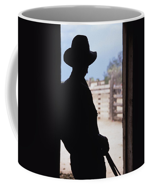 Santa Fe Coffee Mug featuring the photograph Silhouette Of A Cowboy In A Doorway by Stacy Gold