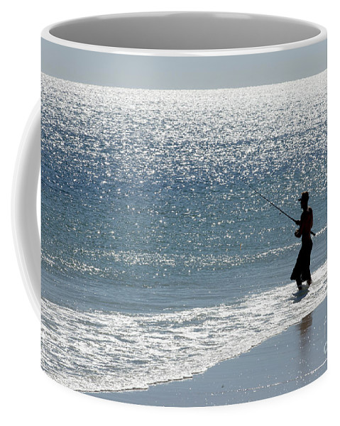 Fishing Coffee Mug featuring the photograph Silhouette Of A Man Fishing by Anthony Totah