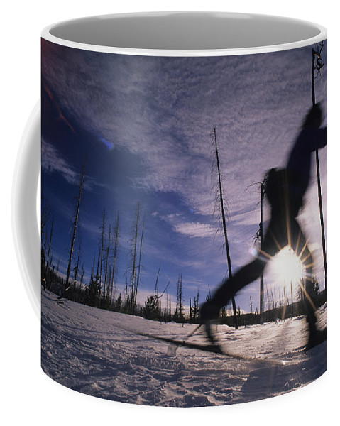 Wyoming Coffee Mug featuring the photograph Silhouette Of Of Women Cross County by Bobby Model