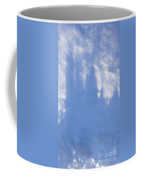 Silhouette Coffee Mug featuring the photograph Silhouette Of Sky Scrapers Reflected In The Clouds by Lilliana Mendez