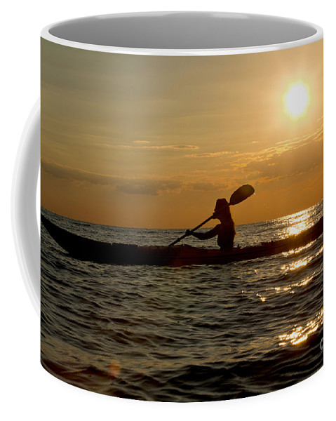 Athlete Coffee Mug featuring the photograph Silhouette Of Woman Kayaking In The Ocean. by Anthony Totah