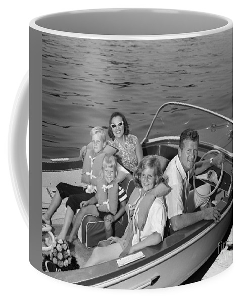 1960s Coffee Mug featuring the photograph Smiling Family In Docked Boat, C.1960s by H. Armstrong Roberts/ClassicStock