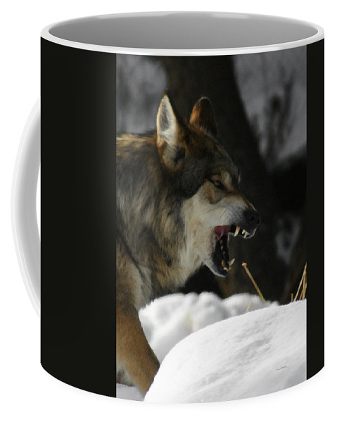 Wolf Coffee Mug featuring the photograph Snarling Wolf by Ernie Echols