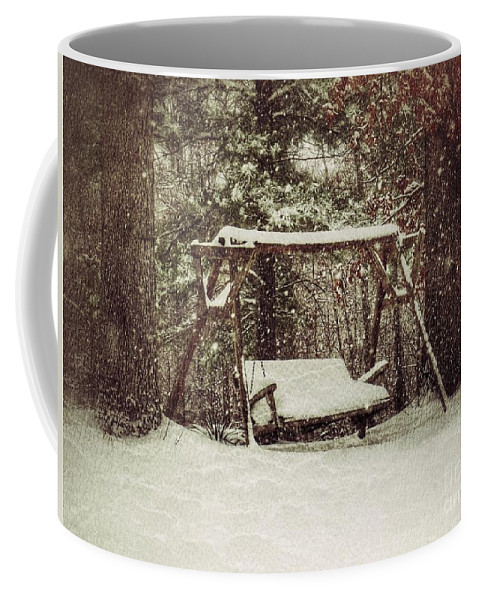 Swing In The Snow Coffee Mug featuring the photograph Snow Covered Swing by John Myers