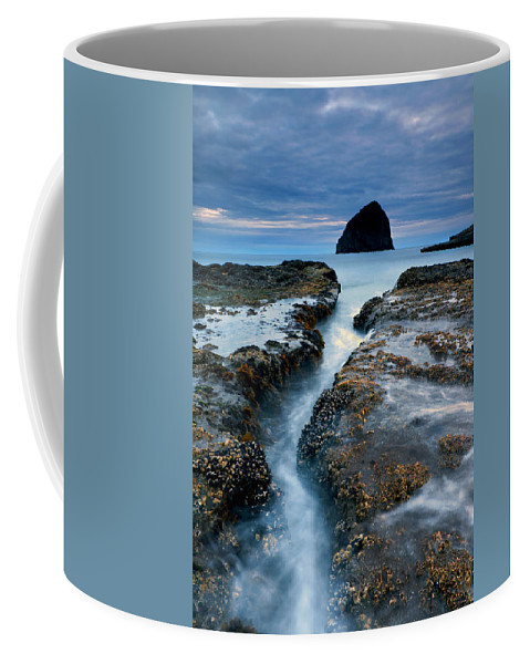 Cape Kiwanda Coffee Mug featuring the photograph Splitting Stone by Mike Dawson