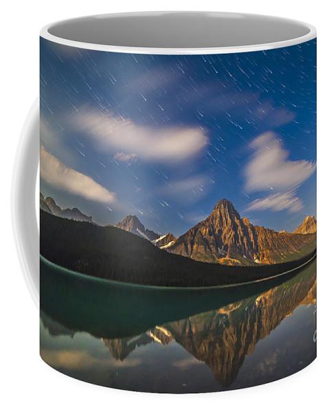 Banff National Park Coffee Mug featuring the photograph Star Trails Behind Mount Chephren by Alan Dyer