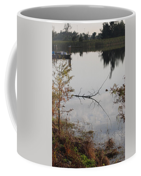 Water Coffee Mug featuring the photograph Stick In The Water by Rob Hans