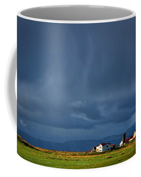 Iceland Coffee Mug featuring the photograph Storm Clouds Over Farmland - Iceland by Stuart Litoff
