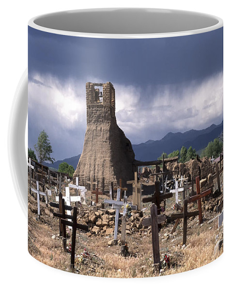 New Mexico Coffee Mug featuring the photograph Storm Over Taos Graveyard by Sandra Bronstein