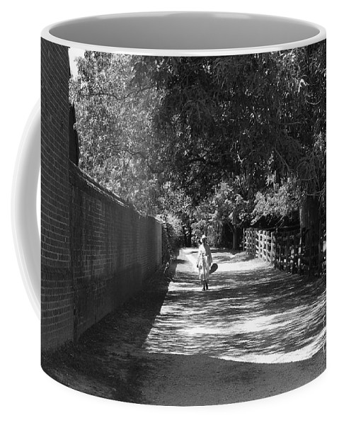 Colonial Coffee Mug featuring the photograph Stroll To Store by Eric Liller