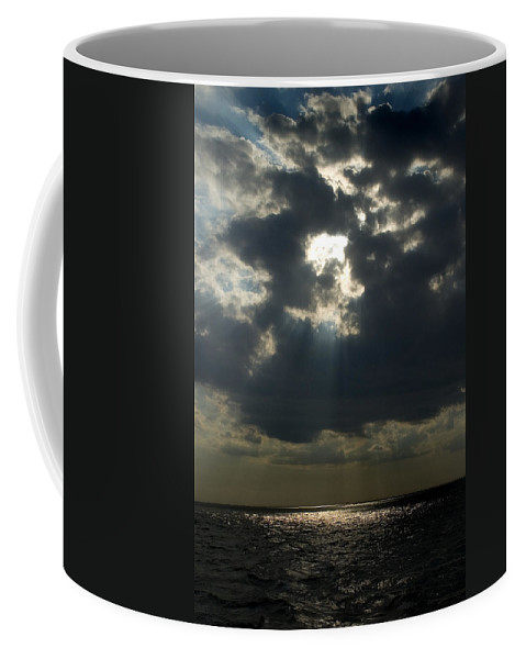 Photography Coffee Mug featuring the photograph Sun Rays Pierce Through Clouds And Rest by Todd Gipstein