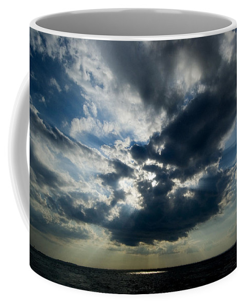 Photography Coffee Mug featuring the photograph Sun Rays Through Clouds Form A Spot by Todd Gipstein