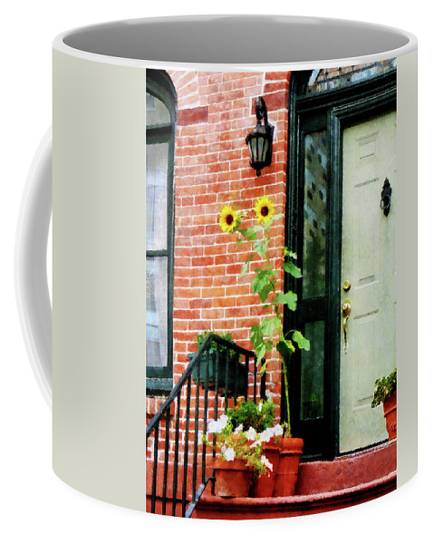 Sunflower Coffee Mug featuring the photograph Sunflowers On Stoop by Susan Savad
