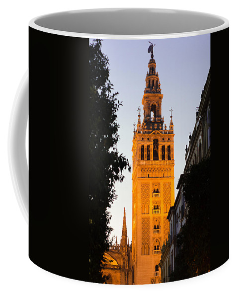 Seville Coffee Mug featuring the photograph Sunset In Seville - A View Of The Giralda by Andrea Mazzocchetti