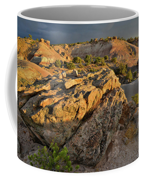 Little Park Road Bentonite Site Coffee Mug featuring the photograph Sunset On Boulders Of Bentonite Site On Little Park Road by Ray Mathis