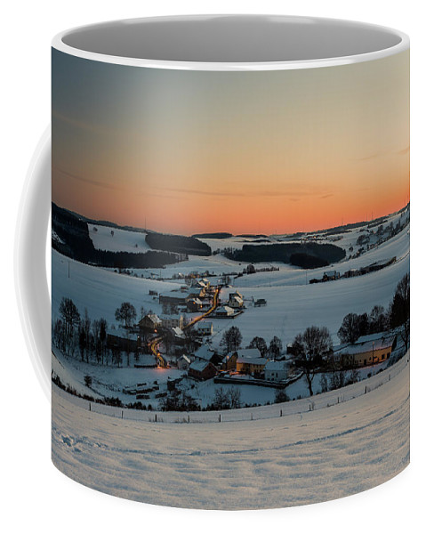 Cold Temperature Coffee Mug featuring the photograph Sunset Over Winter Landscape by Manuel Posch