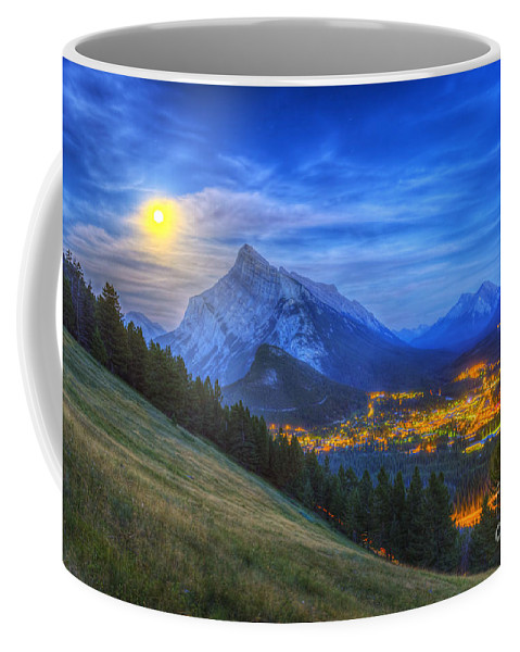 Banff Coffee Mug featuring the photograph Supermoon Rising Over Mount Rundle by Alan Dyer