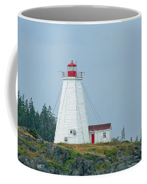 Lighthouse Coffee Mug featuring the photograph Swallowtail Lighthouse by Thomas Marchessault
