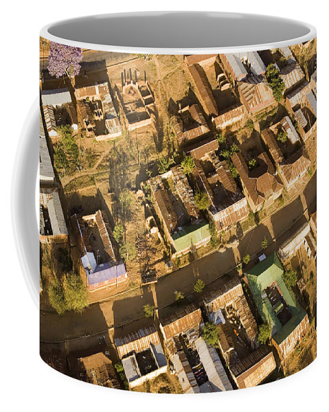 Africa Coffee Mug featuring the photograph Tanzanian Courtyard Homes Are Clustered by Michael Fay