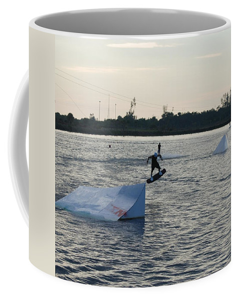 Water Coffee Mug featuring the photograph The After Jump by Rob Hans