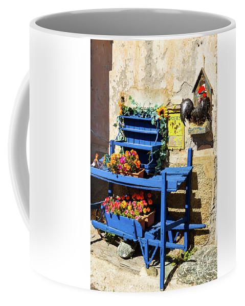 Wheelbarrow Coffee Mug featuring the photograph The Blue Wheelbarrow by Paul MAURICE