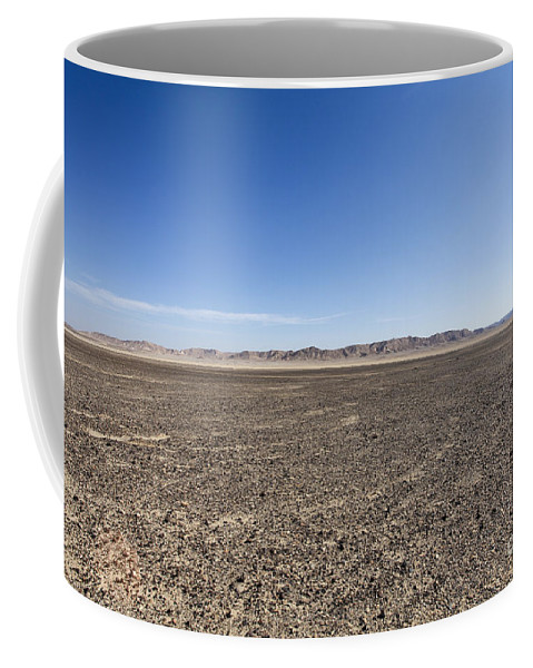 Israel Coffee Mug featuring the photograph The Bulbus Rock Field In Front Of Mount Zin by Gal Eitan