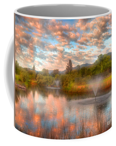 Clouds Coffee Mug featuring the photograph The Cotton Candy Sky by Tara Turner
