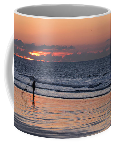 Beach Coffee Mug featuring the photograph The Fisherman by Brothers Beerens