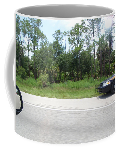 Getaway Coffee Mug featuring the photograph The Getaway by Are Lund