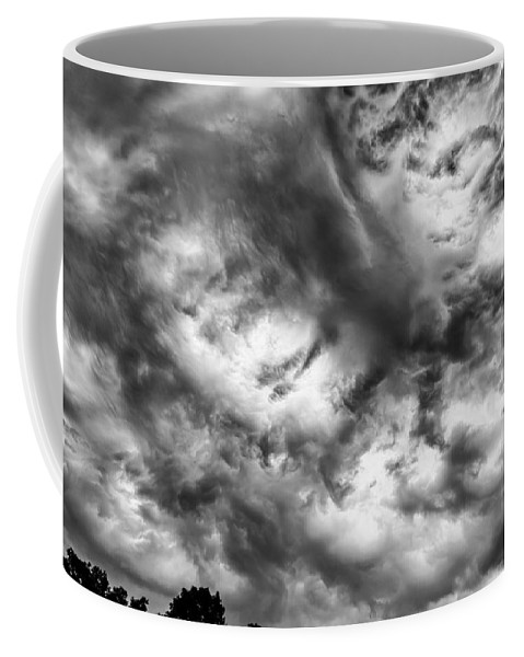 Storm Clouds Coffee Mug featuring the photograph The Loop by Charles McCleanon