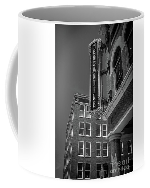 Black Coffee Mug featuring the photograph The Mercantile by Donald Carr