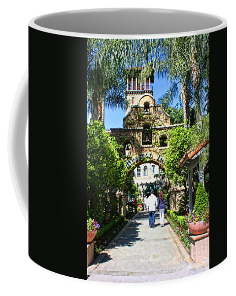Mission Inn Coffee Mug featuring the photograph The Mission Inn Stage Coach Entrance by Tommy Anderson
