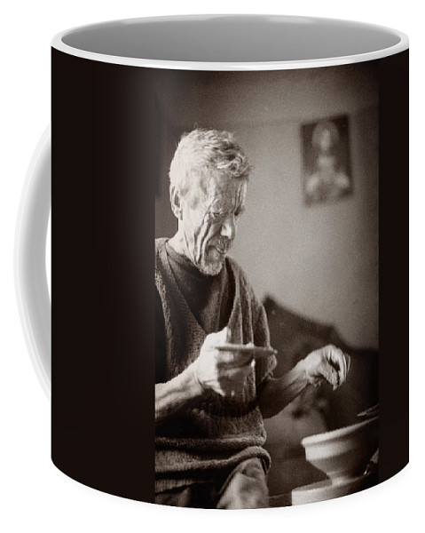 Ukraine Coffee Mug featuring the photograph The Potter Of Haweryvschyna by Yuri Lev