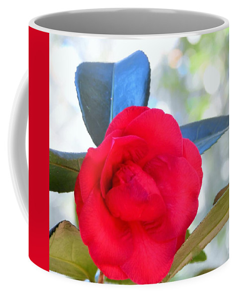 Flower Coffee Mug featuring the photograph The Red Camellia by Jan Gelders
