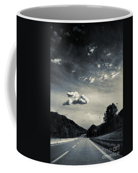 Road Coffee Mug featuring the photograph The Road And The Clouds by Silvia Ganora