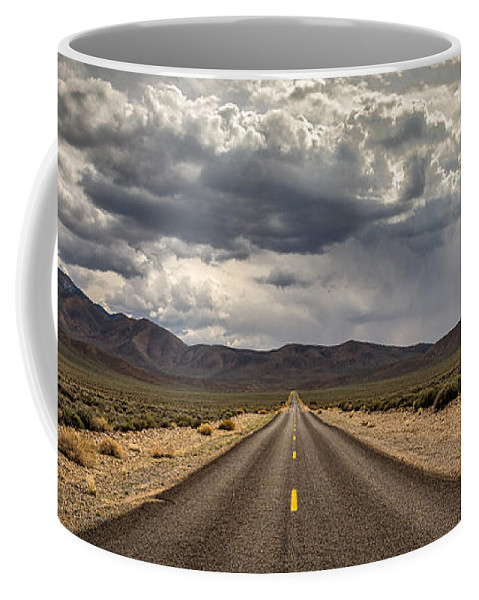 Big Sky Coffee Mug featuring the photograph The Road To Death Valley by Peter Tellone