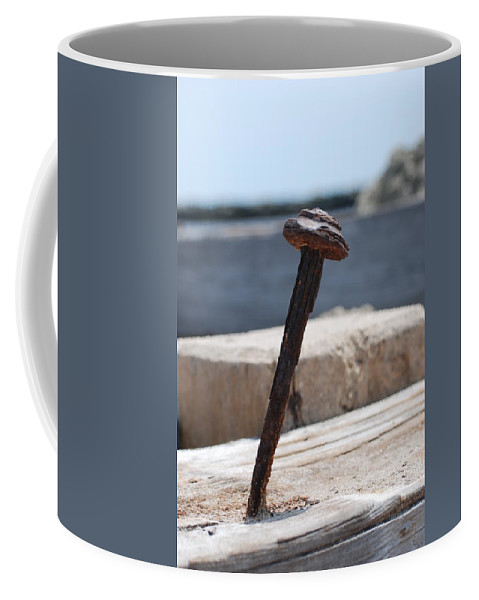 Sand Coffee Mug featuring the photograph The Rusted Spike by Rob Hans
