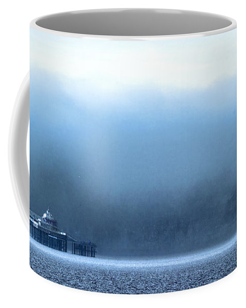 Pier Coffee Mug featuring the photograph The Sea Mist Lifts To Reveal The Great Orme Behind Llandudno Pier by Mal Bray