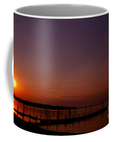Clay Coffee Mug featuring the photograph The Sun Sets Over The Water by Clayton Bruster