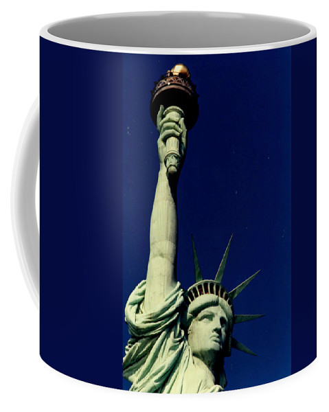 Statue Of Liberty Coffee Mug featuring the photograph The Torch Still Burns by Laura Corebello