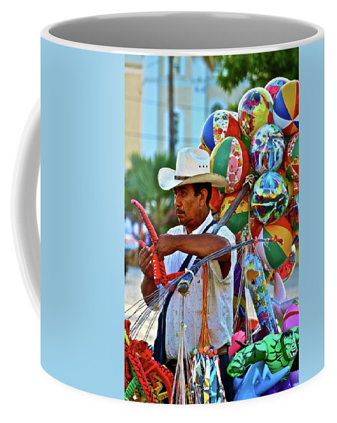 Toys Coffee Mug featuring the photograph The Toy Man by Diana Hatcher