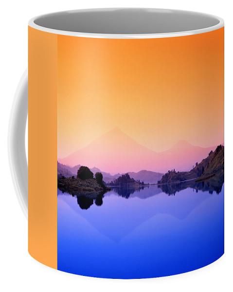 Lake Mutanda Coffee Mug featuring the photograph The Virunga Mountains Rise Above Lake by David Pluth